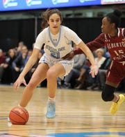 Sonia Citron from The Ursuline School drives the ball around Albertus Magnus' Cyan Bullock during their girls basketball game at the Slam Dunk Tournament at the Westchester County Center in White Plains, Dec. 21, 2019. Ursuline beat Magnus, 63-58.