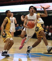 Scarsdale's Jayshen Saigal drives to the basket in front of Mount St. Michael, during their basketball game at the Slam Dunk Tournament at the Westchester County Center in White Plains, Dec. 21, 2019. Mount St. Michael beat Scarsdale, 60-52.