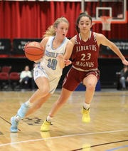 Alexa Mustafaj from The Ursuline School drives the ball around Albertus Magnus' Paulina Paris during their girls basketball game at the Slam Dunk Tournament at the Westchester County Center in White Plains, Dec. 21, 2019. Ursuline beat Magnus, 63-58.