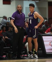 New Rochelle head coach Rasaun Young, left, talks to New Rochelle's Prakash Ketterhagen (4) on the sideline in the opening round of the Slam Dunk Basketball Tournament at the Westchester County Center in White Plains on Saturday, December 21, 2019.