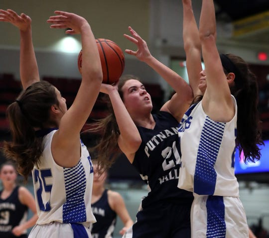 Putnam Valley's Eva Dechent drives between Dobbs Ferry's Talia Reath, left, and Julia Schwabe during their Slam-Dunk Tournament challenge game at the Westchester County Center Dec. 20, 2019.