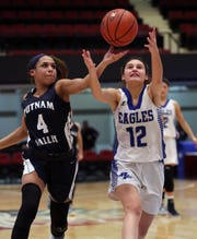 Putnam Valley's Cyera Daughtry, left, fights for the ball with Dobbs Ferry's Kristin Trezza during their Slam-Dunk Tournament challenge game at the Westchester County Center Dec. 20, 2019.