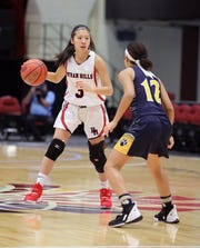 Byram Hills' Jen Mui works the ball around Walter Panas' Kat Reynoso during the Slam Dunk Tournament at the Westchester County Center in White Plains, Dec. 21, 2019. Byram Hills beat Walter Panas, 49-44.