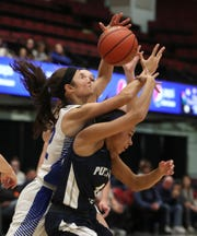 Dobbs Ferry's Julia Schwabe, left, fights for a rebound with Putnam Valley's Cyera Daughtry during their Slam-Dunk Tournament challenge game at the Westchester County Center Dec. 20, 2019.