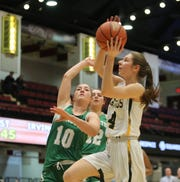Hastings' Lindsay Drozd (4) drives to the basket during the Slam Dunk Basketball Tournament at the Westchester County Center in White Plains on Saturday, December 21, 2019.