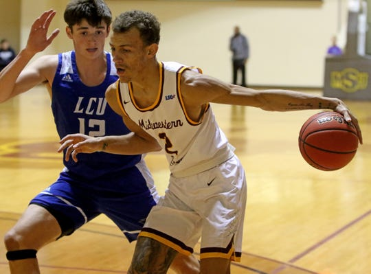 Midwestern State's Trae Jones dribbles by Lubbock Christian's Ty Caswell Saturday, Dec. 21, 2019, at D.L. Ligon Coliseum.