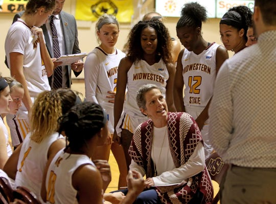 Midwestern State head basketball coach Noel Johnson talks to her players during a timeout in the game against Lubbock Christian Saturday, Dec. 21, 2019, at D.L. Ligon Coliseum.