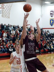 John Glenn's Reece Perkins goes up for a shot in the lane during the fourth quarter against Sheridan on Friday night. The Generals won, 50-42.