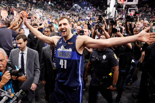 April 10: Dallas Mavericks forward Dirk Nowitzki high-fives fans while leaving the court after his final NBA game.
