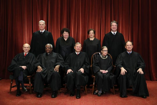 United States Supreme Court justices pose for their official portrait at the in the East Conference Room at the Supreme Court building November 30, 2018 in Washington, D.C.