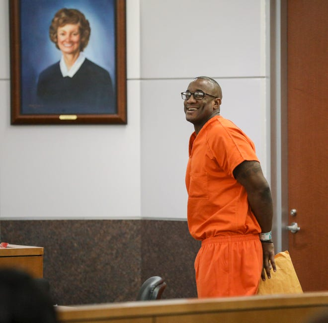 In this Tuesday, Nov. 26, 2019 file photo, Lydell Grant smiles in court after he was ordered to be released on bond in Houston. On Friday, Dec. 20, 2019, the Harris County District Attorney's Office said that Grant has been cleared in the death of 28-year-old Aaron Scheerhoorn.