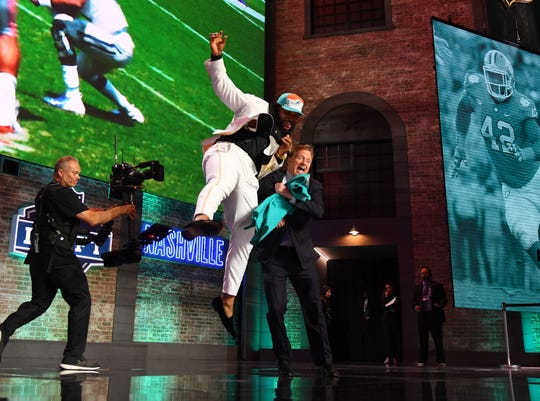 April 25: Christian Wilkins (Clemson) celebrates with NFL commissioner Roger Goodell after he was selected as the No. 13 overall pick to the Miami Dolphins in the NFL draft.