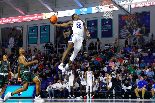 Jarace Walker #25 of IMG Academy goes up for a dunk against Fort Myers High School during the City of Palms Classic Day 2 at Suncoast Credit Union Arena on December 19, 2019 in Fort Myers, Florida.