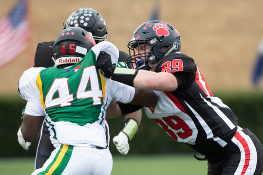 South Carolina's Will Blackston (89), from Belton-Honea Path High School, faces North Carolina's Jaki Brevard (44), from South Durham High School, during the 83rd Shrine Bowl of the Carolinas at Wofford's Gibbs Stadium Saturday, Dec. 21, 2019.