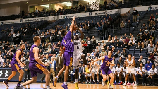 Monmouth's Ray Salnave scores on a drive with 2.8 seconds to play to lift the Hawks to a 72-70 victory over Albany at OceanFirst Bank Center on Dec. 21, 2019.