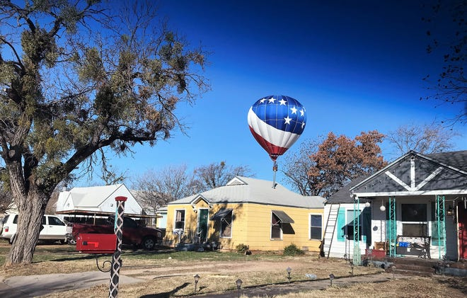 A hot air balloon skimmed over Abilene on Sunday morning, dropping low over Rose Park, as seen from South 10th Street, then rose only to go low again and land in a lot between South First and Second streets south of El Fenix restaurant. There were no issues, just a touch-and-go experience for the crew. Some personnel changed in the basket at the lot, then the balloon rose again to continue its northward trek. It did create a vehicle on city streets, following behind the balloon chase crew in a yellow former school bus.