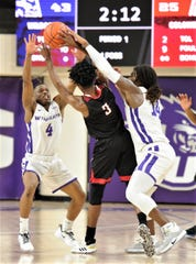 ACU's Damien Daniels, left, and Trey Lenox, right, pressure Nicholls' Kevin Johnson in the first half. The Wildcas beat Nicholls 79-61 in the Southland Conference game Saturday, Dec. 21, 2019, at Moody Coliseum.