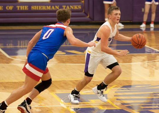 Unioto's Isaac Little dribbles the ball near half court during a 38-36 win over Zane Trace at Unioto High School in Chillicothe, Ohio, on Dec. 21, 2019.