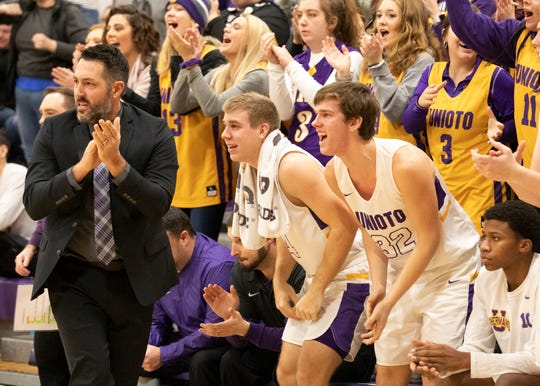 Unioto head coach Matt Hoops and his team celebrates during a 38-36 win over Zane Trace at Unioto High School in Chillicothe, Ohio, on Dec. 21, 2019.