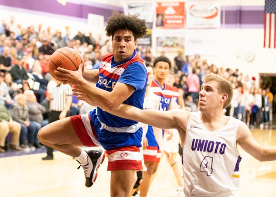 Unioto's Nate Keiser looks to take the ball from Zane Trace's Cam Evans during a 38-36 win over Zane Trace  at Unioto High School in Chillicothe, Ohio, on Dec. 21, 2019.