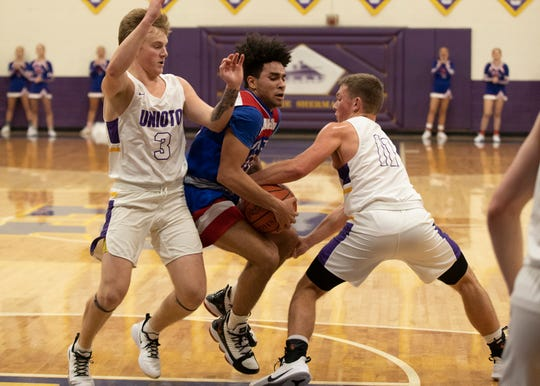 Unioto's Isaac Little attempts to steal the ball from Zane Trace's Cam Evans during Unioto's 38-36 win at Unioto High School in Chillicothe, Ohio, on Dec. 21, 2019.