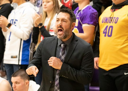 Unioto High School's head basketball coach Matt Hoops coaches the team from the bench during a 38-36 win over Zane Trace at Unioto High School in Chillicothe, Ohio, on Dec. 21, 2019. Hoops will now also be the school's head football coach.