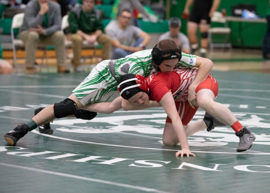 Huntington High School wrestler Thomas Dayland defeated Wahama wrestler Emma Tomlinson to take first place in the 106-pound weight class at the 2019 Huntington Wrestling Invitational on Dec. 21, 2019. Dayland also received the 2019 Wyatt Wheeler award for the most outstanding wrestler, which is voted on by the coaches of the tournament. Huntington hosted 10 wrestling teams with area teams including Adena, Huntington, and Waverly.