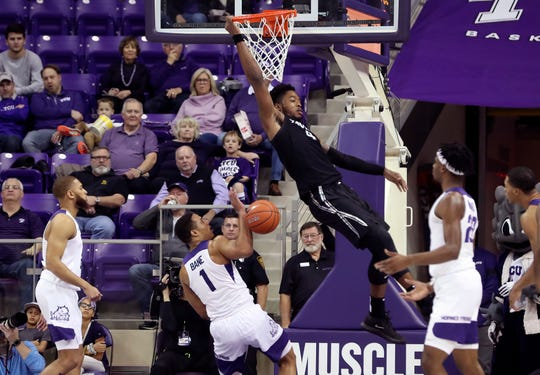 Dec 22, 2019; Fort Worth, Texas, USA;  Xavier Musketeers forward Tyrique Jones (4) dunks past TCU Horned Frogs guard Desmond Bane (1) during the first half at Ed and Rae Schollmaier Arena.