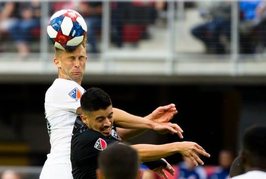 FC Cincinnati midfielder Caleb Stanko (33) heads the ball over D.C. United defender Marquinhos Pedroso (6) in the first half of the MLS match between FC Cincinnati and D.C. United on Sunday, Oct. 6, 2019, in Washington D.C. at Audi Field.