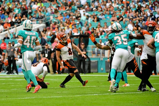 Dec 22, 2019; Miami Gardens, Florida, USA; Cincinnati Bengals kicker Randy Bullock (4) looks on after kicking a field goal against the Miami Dolphins during the first half at Hard Rock Stadium.