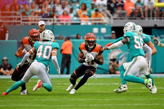 Dec 22, 2019; Miami Gardens, Florida, USA; Cincinnati Bengals wide receiver John Ross (11) rushes with the ball against the Miami Dolphins during the first half at Hard Rock Stadium.