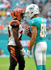 Dec 22, 2019; Miami Gardens, Florida, USA; Cincinnati Bengals cornerback Tony McRae (29) and Miami Dolphins wide receiver Trevor Davis (89) exchange words during the first half at Hard Rock Stadium.
