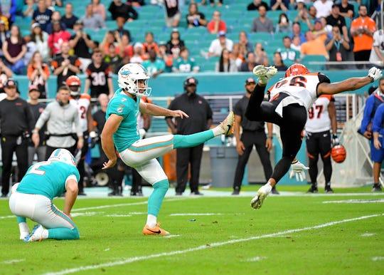 Dec 22, 2019; Miami Gardens, Florida, USA; Miami Dolphins kicker Jason Sanders (7) kicks the game winning field goal in overtime against the Cincinnati Bengals at Hard Rock Stadium.