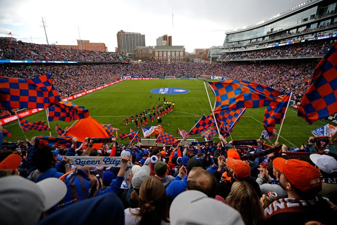 The Bailey cheers and waves flags as both teams take the field before the first half of the MLS match between FC Cincinnati and the Portland Timbers at Nippert Stadium in Cincinnati on Sunday, March 17, 2019. FC Cincinnati led 1-0 at halftime.