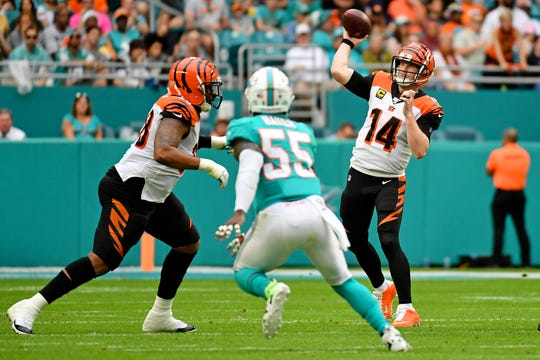 Dec 22, 2019; Miami Gardens, Florida, USA; Cincinnati Bengals quarterback Andy Dalton (14) attempts a pass against the Miami Dolphins during the first half at Hard Rock Stadium.