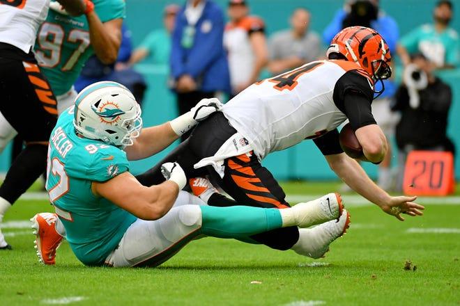 Zach Sieler of Pinckney sacks Cincinnati Bengals quarterback Andy Dalton while playing for the Miami Dolphins on Dec. 22, 2019.