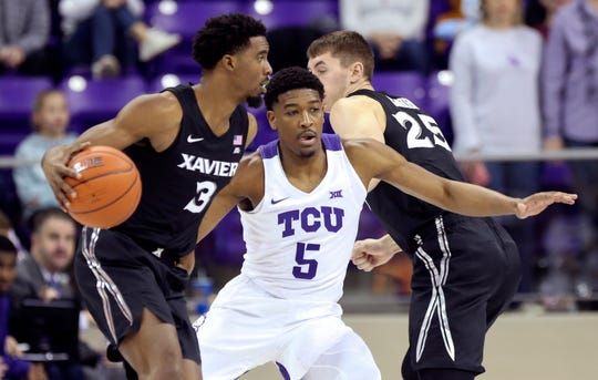 Dec 22, 2019; Fort Worth, Texas, USA;  Xavier Musketeers guard Quentin Goodin (3) dribbles as TCU Horned Frogs guard Jaire Grayer (5) defends during the first half at Ed and Rae Schollmaier Arena.
