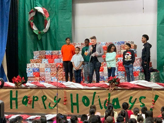 More than 400 students in New Brunswick's Livingston Elementary School received holiday gifts at a surprise event Friday. The effort was coordinated by district physical education teacher Jennifer Olawski and was financed via an online GoFundMe initiative that raised $10,000.