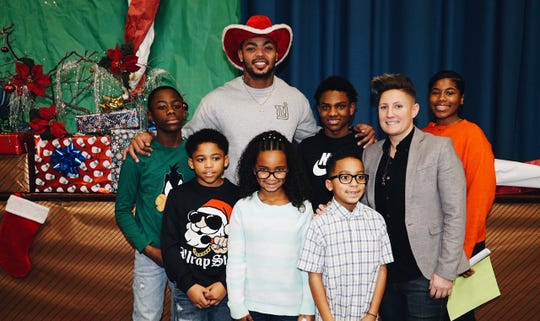 More than 400 students in New Brunswick's Livingston Elementary School received holiday gifts at a surprise event Friday. The effort was coordinated by district physical education teacher Jennifer Olawski and was financed via an online GoFundMe initiative that raised $10,000. Former NFL Giant and New Brunswick High School alumus Jonathan Casillas joined in the fun and handed out 400 candy canes to the students.