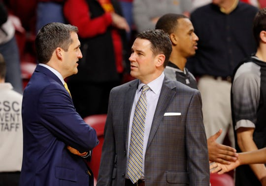 Iowa State head coach Steve Prohm, left, talks with Purdue Fort Wayne head coach Jon Coffman, right, before an NCAA college basketball game, Sunday, Dec. 22, 2019, in Ames, Iowa. (AP Photo/Matthew Putney)