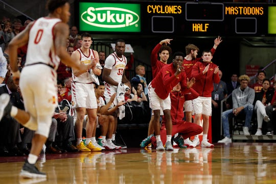 The Iowa State bench cheers after a three point basket by Iowa State forward Zion Griffin, left, during the first half of an NCAA college basketball game against Purdue Fort Wayne, Sunday, Dec. 22, 2019, in Ames, Iowa. (AP Photo/Matthew Putney)