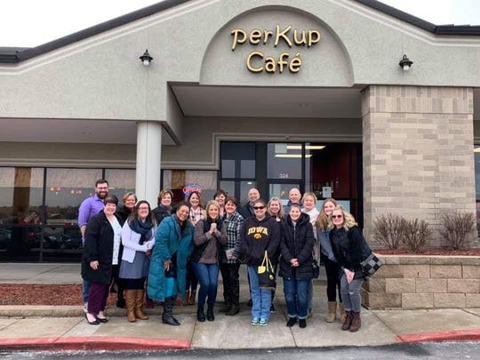 Inspired by a Facebook post, Michelle Becker of Adel recently organized a group of her friends to share large tips with their servers at PerKup Cafe in West Des Moines.