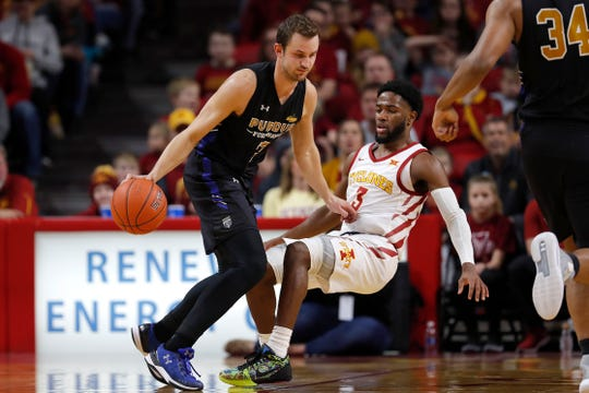 Purdue Fort Wayne forward Matt Holba, left, drives to the basket as he fouls Iowa State guard Tre Jackson during the first half of an NCAA college basketball game, Sunday, Dec. 22, 2019, in Ames, Iowa. (AP Photo/Matthew Putney)