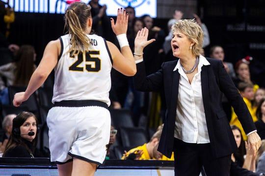 Iowa head coach Lisa Bluder gives Iowa center Monika Czinano (25) a high-five as she heads to the bench during a NCAA non-conference women's basketball game, Saturday, Dec. 21, 2019, at Carver-Hawkeye Arena in Iowa City, Iowa.