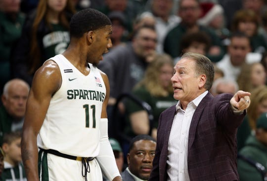 Michigan State Spartans head coach Tom Izzo talks to Michigan State Spartans forward Aaron Henry (11) during the first half of a game at the Breslin Center on Saturday, Dec. 21, 2019.