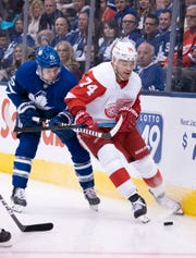 Toronto Maple Leafs center Alexander Kerfoot (15) battles for a puck with Detroit Red Wings defenseman Madison Bowey (74) during the first period at Scotiabank Arena in Toronto, Saturday, Dec. 21, 2019.