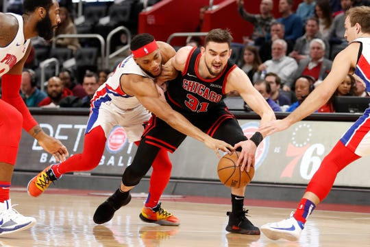 Chicago Bulls guard Tomas Satoransky (31) tries to maintain control of the ball defended by Detroit Pistons guard Bruce Brown and center Andre Drummond (left) and guard Luke Kennard (right) during the first quarter at Little Caesars Arena on Saturday, Dec. 21, 2019.