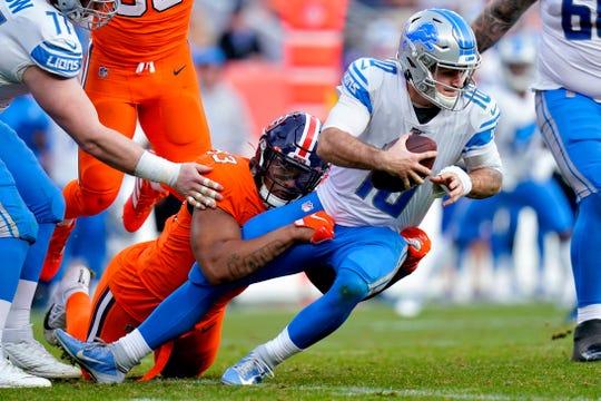 Broncos defensive end Dre'Mont Jones sacks Lions quarterback David Blough during the first half on Sunday, Dec. 22, 2019, in Denver.