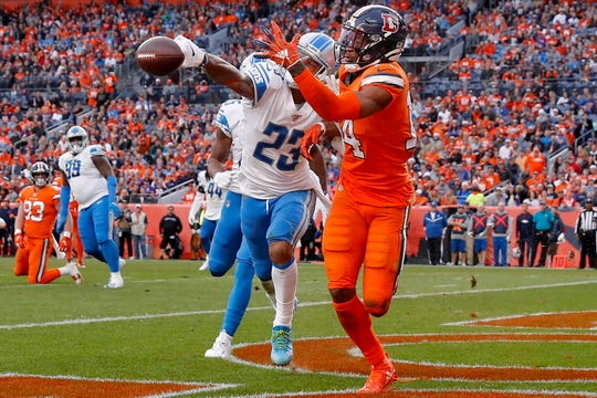 Lions cornerback Darius Slay knocks away a pass in the end zone intended for Broncos wide receiver Courtland Sutton during the second half on Sunday, Dec. 22, 2019, in Denver.