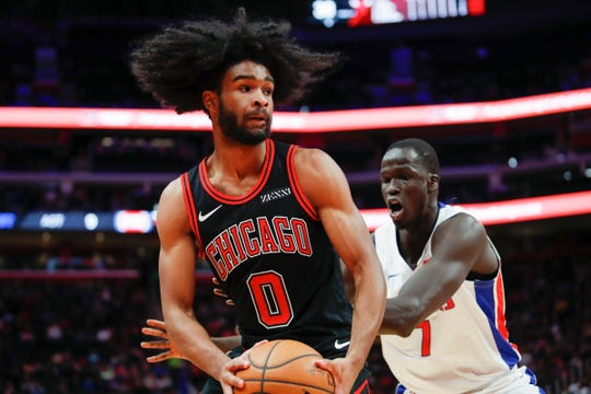 Chicago Bulls guard Coby White (0) defended by Detroit Pistons forward Thon Maker (7) during the second quarter at Little Caesars Arena on Saturday, Dec. 21, 2019.